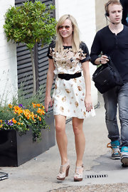 Amanda looked cheerful in a printed silk day dress with neutral wooden wedges.