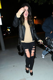 Shenae Grimes left Trousdale in black leather platforms with squared toes.