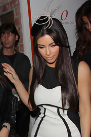 Kim Kardashian added a playful touch to her look at Perez Hilton's birthday party with this decorative head piece.