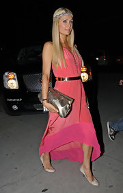 Paris Hilton arrived at a restaurant in Beverly Hills wearing a pair of champagne satin pumps featuring sparkling embellishments.