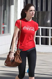 Ashley Greene showed her love for her favorite cola in a red graphic T-shirt.