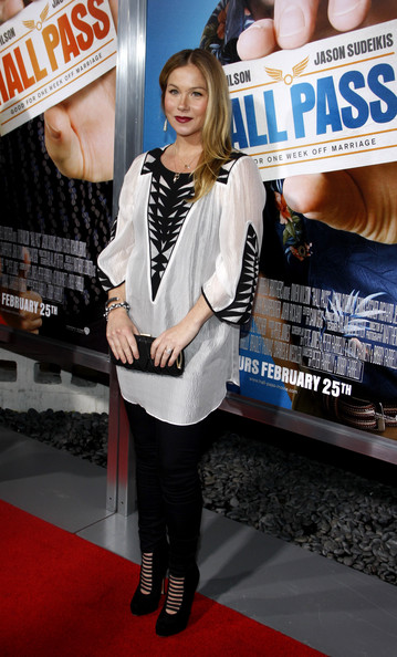 Christina Applegate paired her casual red carpet look with sultry black suede Helix ankle boots with elastic straps.