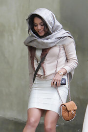 Vanessa Hudgens wrapped a silver monogrammed pashmina around her head while running errands.