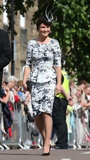 Pippa Middleton wowed in a white and black floral peplum dress at Melissa Percy's wedding.