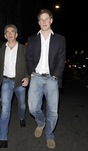 Prince Harry wore a pair of classic faded jeans and a blazer for his night out in London.