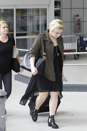 Demi paired a dark green army jacket over her flowing dress for a cool mix of textures.
