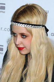 Peaches accessorized with a crystal leaved headband. This is a fun evening look that adds a little glitz to a simple ensemble.