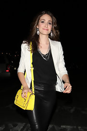 Emmy Rossum embraced color with a bold yellow Essex Scout satchel.