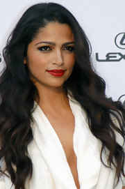 Camila Alves spiced up her look at the Casino de Madrid event with a vivid red pout. It was the perfect way to contrast her smoky lids.
