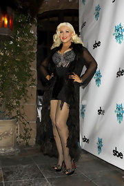 Christina Aguilera was a vision in black lace bow platforms.