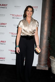 Brook Shields paired her pants look with a petite gold box clutch.