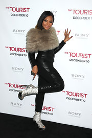 Ashanti showed off a pair of over the top snakeskin ankle boots with metallic platforms and peep toes. She paired the funky footwear with a leather suit and fur capelet for a dare to be different look.