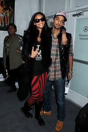 Chanel dons red and black leggings while posing with her boyfriend in NY.
