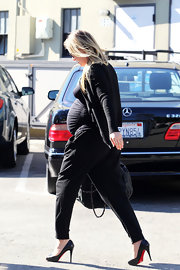 "A very pregnant Ali Larter embodied the ""vain over pain"" mantra in towering Christian Louboutin pumps. We applaud her commitment to maternity chic!"