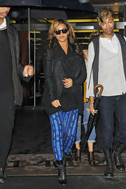 Beyonce continues to rock her pregnancy in style, wearing vibrant leggings and black lace-up ankle boots.