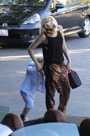 Gwen Stefani completed her outfit in wild style with a pair of leopard-print harem pants.