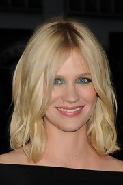 January Jones styled her hair in a simple center part hairstyle equipped with loose waves.