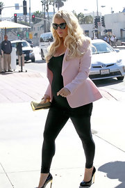 Jessica Simpson is known for her girlie, feminine style like this baby pink blazer she wore while taking a stroll with her husband.