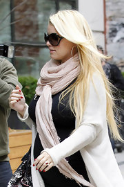 Jessica Simpson matched her shiny scarlet manicure to her stunning ruby ring while heading to a hotel in NYC.