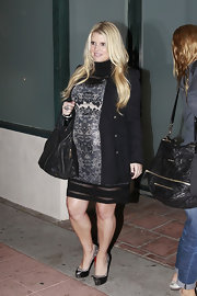 Jessica Simpson polished her tight mini dress with a black school boy-style blazer.