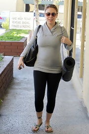 Alyssa wears a tight gray work out top for her yoga class in LA.