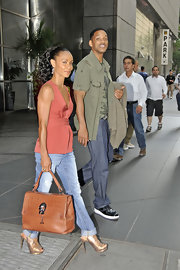 Jada Pinkett Smith was spotted entering CNN in a pair of gold platform lizard-specchio sandals.