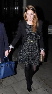 Princess Beatrice accessorized her black print dress with a gold hardcase clutch.