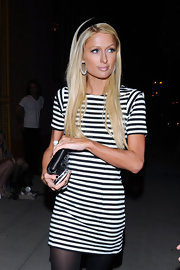 Paris Hilton showed off her long straight locks while heading out in West Hollywood. She added a simple black headband to accentuate her look.