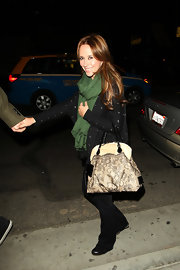 Jennifer Love Hewitt carried a cream tote with black lace overlay to add girly flair to her casual look.
