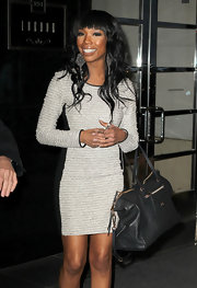 Brandy gave her textured long-sleeved dress a luxe finish with a black leather monogram embossed tote.