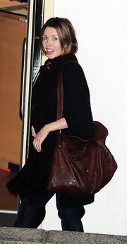 Dannii Minogue slung an oversize brown snakeskin bag over her shoulder. The X Factor judge wore the bag with an all-black ensemble.