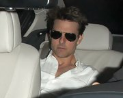 Tom Cruise left his look mysterious with classic Ray-Ban aviators covering-up his face.