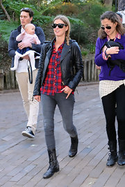Nicky Hilton paired her motorcycle jacket with classic wayfarer sunglasses.