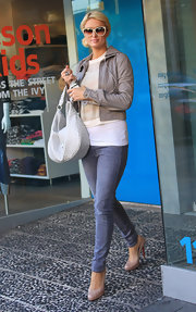 Paris Hilton carried a chic white leather purse while shopping at Kitson.