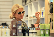 Paris Hilton went shopping in ivory cateye sunglasses.