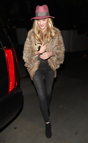 Rosie added luxury to her street style look with this fur shrug.