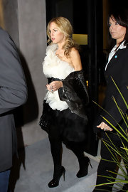 "Rachel completed her look with a pair of black patent leather ""Maniac"" pumps. The popular heels were sexy and elegant but allowed her ivory top to be the main attraction."