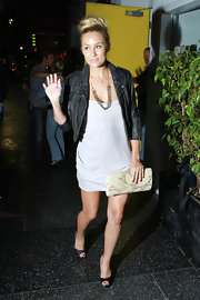 Lauren finished off her look with a snakeskin clutch.