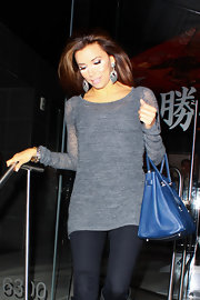 Eva Longoria paired her casual winter attire with a cornflower blue Hermes Birkin.