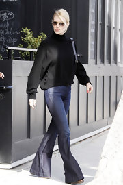 January Jones kept her flared trouser jeans from being too retro with the addition of a slouchy black sweater.