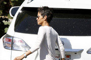 Halle Berry rocks a pair of short shorts as she picks up her daughter Nahla from school. Halle, who is still wearing a cast on her leg after an accident a few months back, is reportedly considering moving to France to get away from US Media and drama with Nahla's father, Gabriel Aubry.