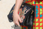 Dakota Johnson Clutches