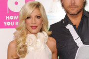 Tori Spelling Long Curls with Bangs