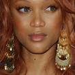 Tyra Banks Gold Dangle Earrings
