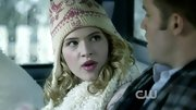 Claudia Lee's pink lips matched the detailing of her ear-flap beanie.