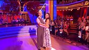 Sharna Burgess chose a printed one-shoulder frock for her dance with comedian Andy Dick.