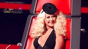 Ever the fashion diva, Christina Aguilera livened up her LBD with this disc head piece.