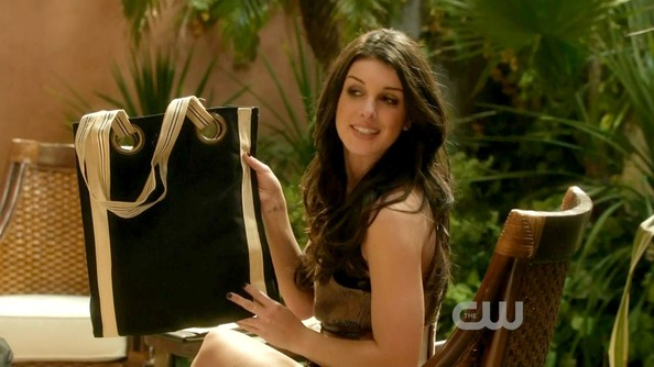Shanae Grimes held up this gold-embellished canvas tote.
