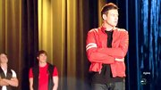 Cory Monteith opted for a cool red motorcycle jacket for his performance look on 'Glee.'