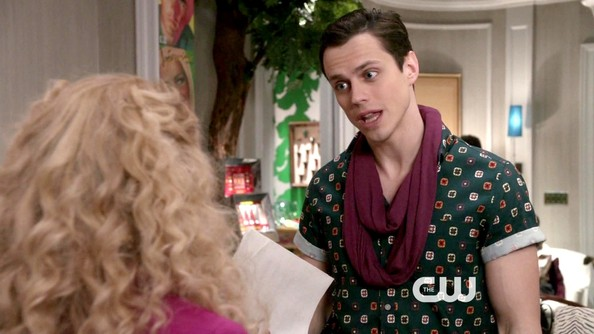 Jake Robinson accessorized his print top with a maroon infinity scarf.